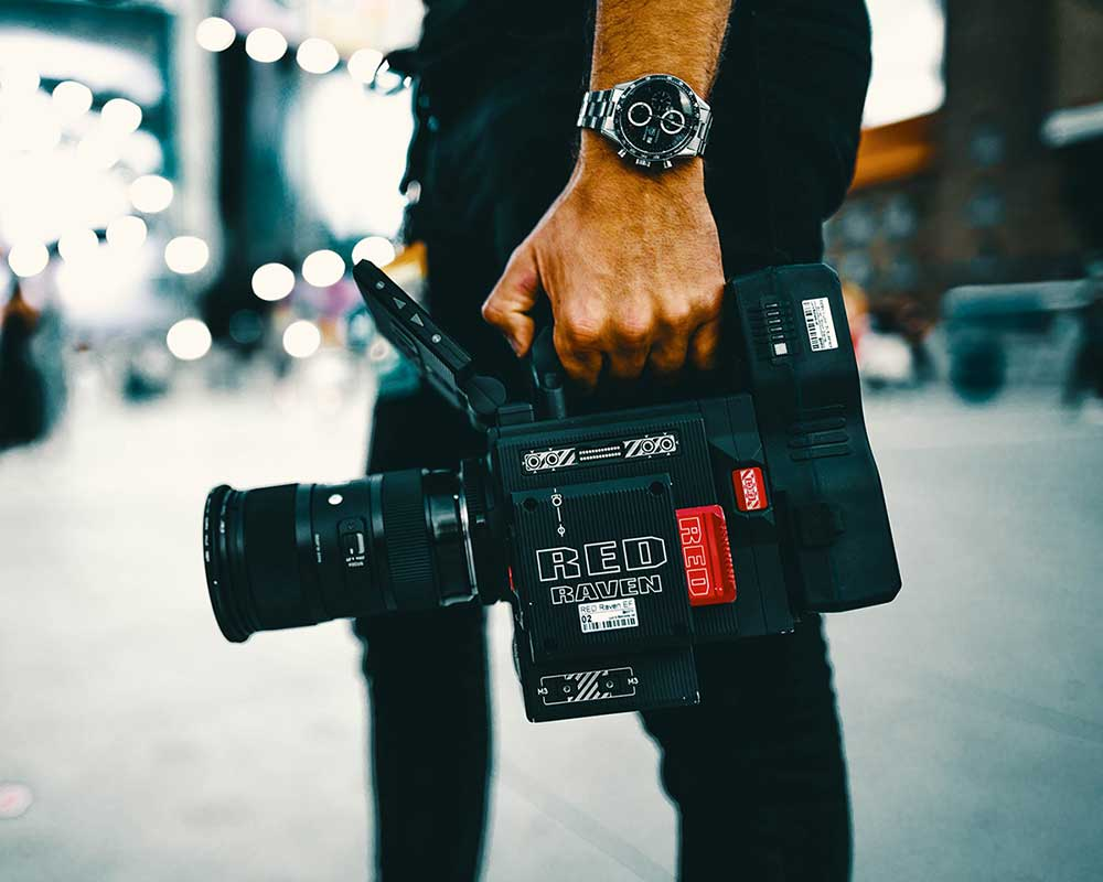 Red camera being hold